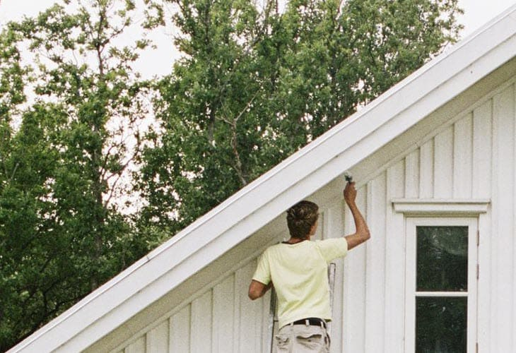 photo of Diaz Painting team member painting exterior trim